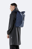 Rains Original Roll Top Backpack blue model man